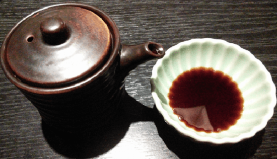Soy sauce and container